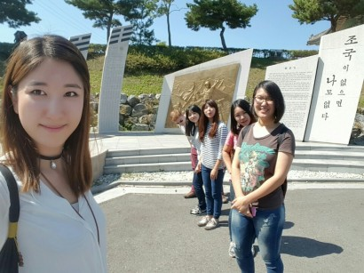 In front of the memorial